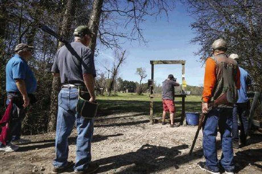 Participants in the Lions Club Clay Shoot fundraiser wait their turn for a shot on Saturday at Creekwood Shooting Sports. Photo: Michael Minasi