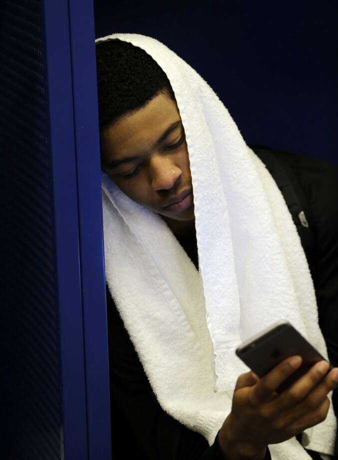 Kentucky's Tyler Ulis cries as he sits in the locker after the NCAA Final Four loss to Wisconsin. Photo: David J. Phillip