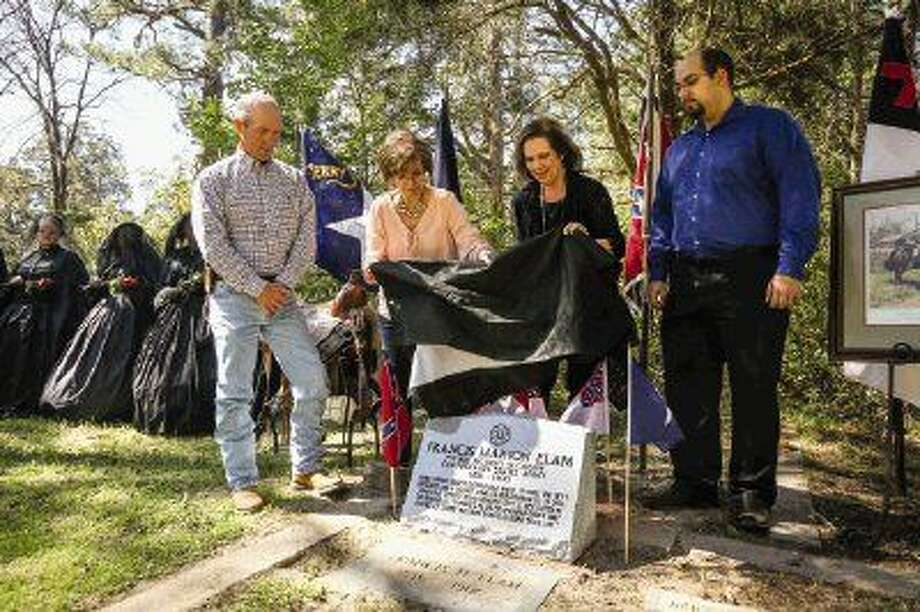 Descendants of Private Francis Elam unveil a new grave marker for the Confederate soldier on Saturday at the Willis Cemetery. To view more photos from the ceremony, go to HCNPics.com. Photo: Michael Minasi