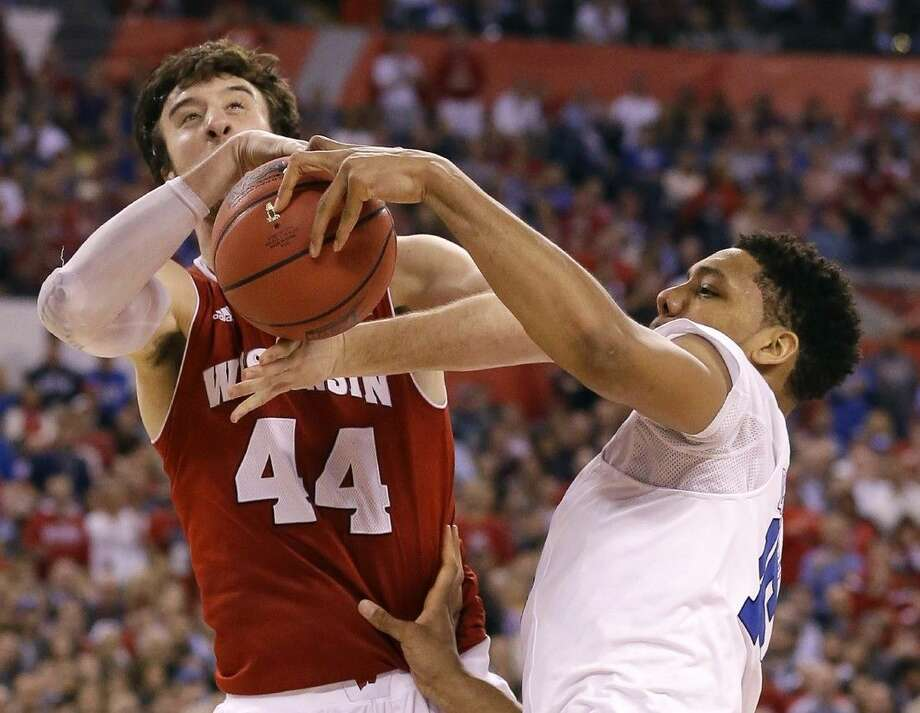 Wisconsin's Frank Kaminsky is fouled by Duke's Jahlil Okafor. Duke won 68-63. Photo: Michael Conroy