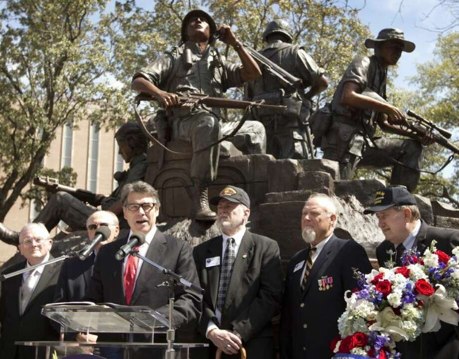 Texas Gov. Rick Perry speaks at the dedication of the Texas state Capitol Vietnam Veterans Monument in Austin Saturday.