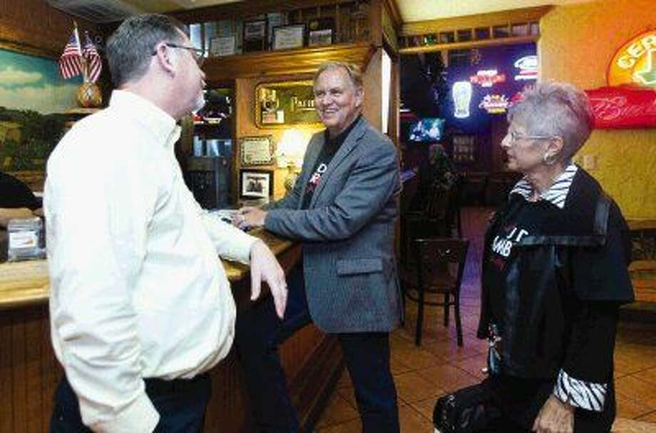 JD Lambright, incumbent Montgomery County Attorney, center, smiles after winning the Republican primary Tuesday against challenger Gary Beauchamp. Photo: Jason Fochtman