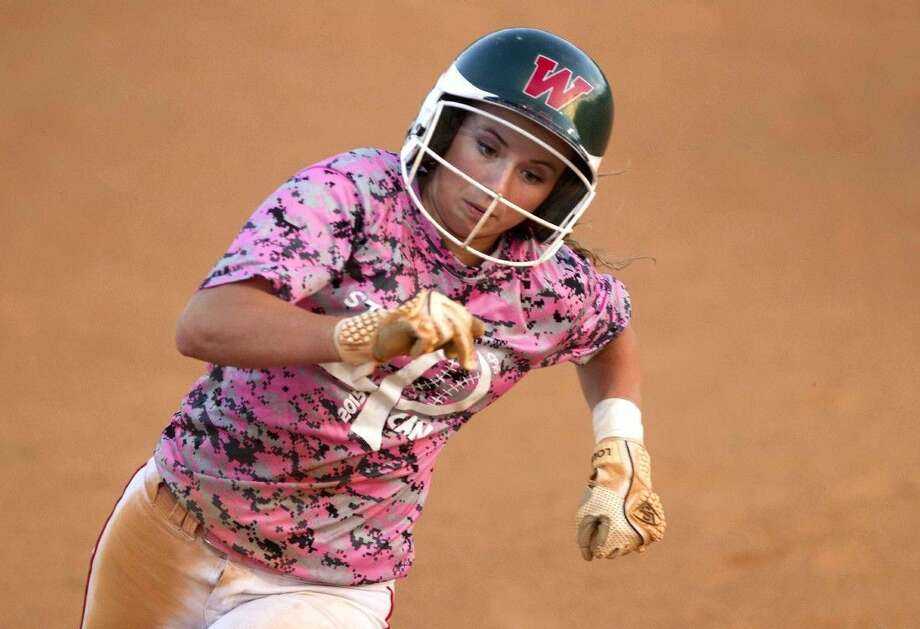 The Woodlands' Aubrey Leach scores a run in the fourth inning of a District 16-6A softball game against Tuesday. Leach finished the game with three runs, two RBIs, three stolen bases and a double in the team's 8-0 win over College Park.
