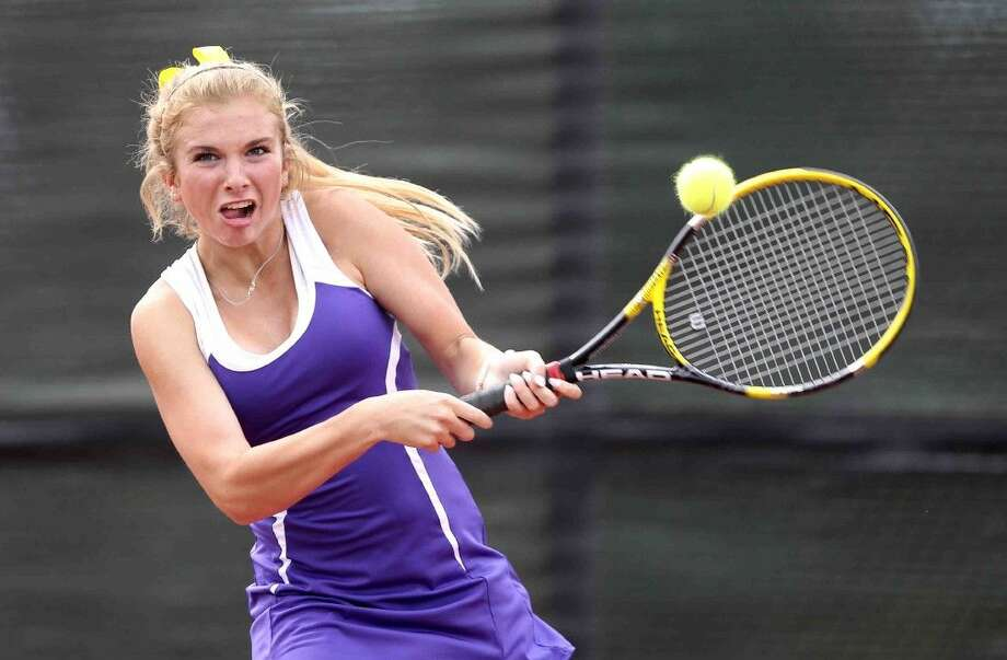 Montgomery's Molly Hinkle returns a serve during the mixed doubles finals of the District 15-6A tennis tournament Wednesday. To view or purchase this photo and others like it, visit HCNpics.com. Photo: Jason Fochtman