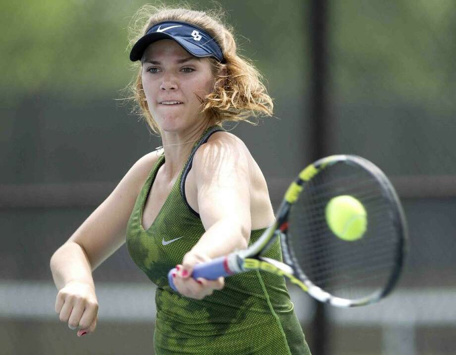 College Park's Reiley Jones returns a hit during the girls doubles section of the District 16-6A tennis tournament Wednesday. To view or purchase this photo and others like it, visit HCNpics.com. Photo: Jason Fochtman