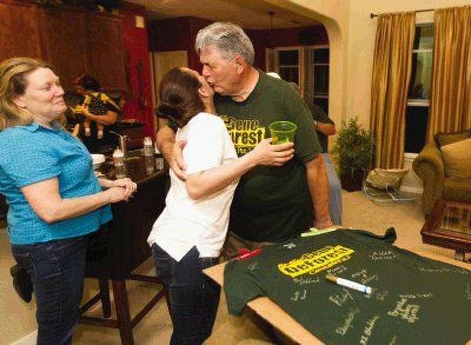 Gene DeForest, incumbent Precinct 2 constable, gets a hug from Deputy Julianne Ferrell after winning the Republican primary Tuesday. Photo: Jason Fochtman