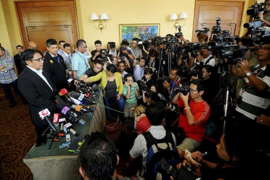 Malaysia's civil aviation chief Azharuddin Abdul Rahman, left, speaks during a press conference after a close door meeting with Chinese relatives of the passengers onboard the missing Malaysia Airlines Flight 370 at a hotel in Bangi, on the outskirts of Kuala Lumpur, Malaysia, Wednesday, April 2, 2014. The plane disappeared March 8 on a flight to Beijing from Kuala Lumpur after its transponders, which make the plane visible to commercial radar, were shut off. A multinational team of aircraft and ships are searching the southern Indian Ocean for the plane, but have yet to find any sign of the Boeing 777. Photo: Joshua Paul