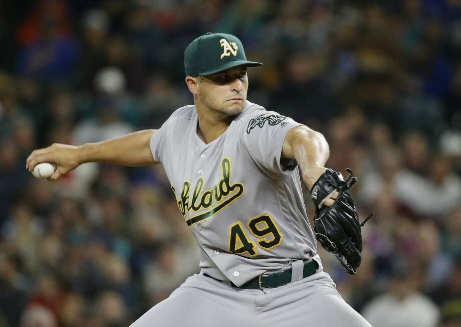 Oakland Athletics starting pitcher Kendall Graveman throws against the Seattle Mariners in the first inning of a baseball game, Thursday, Sept. 29, 2016, in Seattle. (AP Photo/Ted S. Warren) Photo: Ted S. Warren, Associated Press