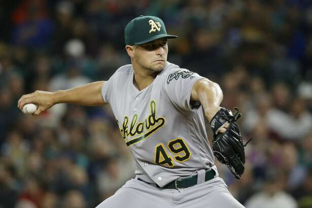Oakland Athletics starting pitcher Kendall Graveman throws against the Seattle Mariners in the first inning of a baseball game, Thursday, Sept. 29, 2016, in Seattle. (AP Photo/Ted S. Warren)