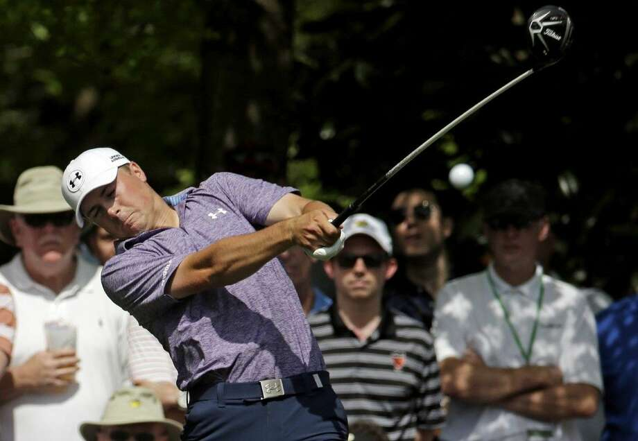 Jordan Spieth tees off on the seventh hole during the second round of the Masters golf tournament Friday in Augusta, Ga. Photo: Charlie Riedel