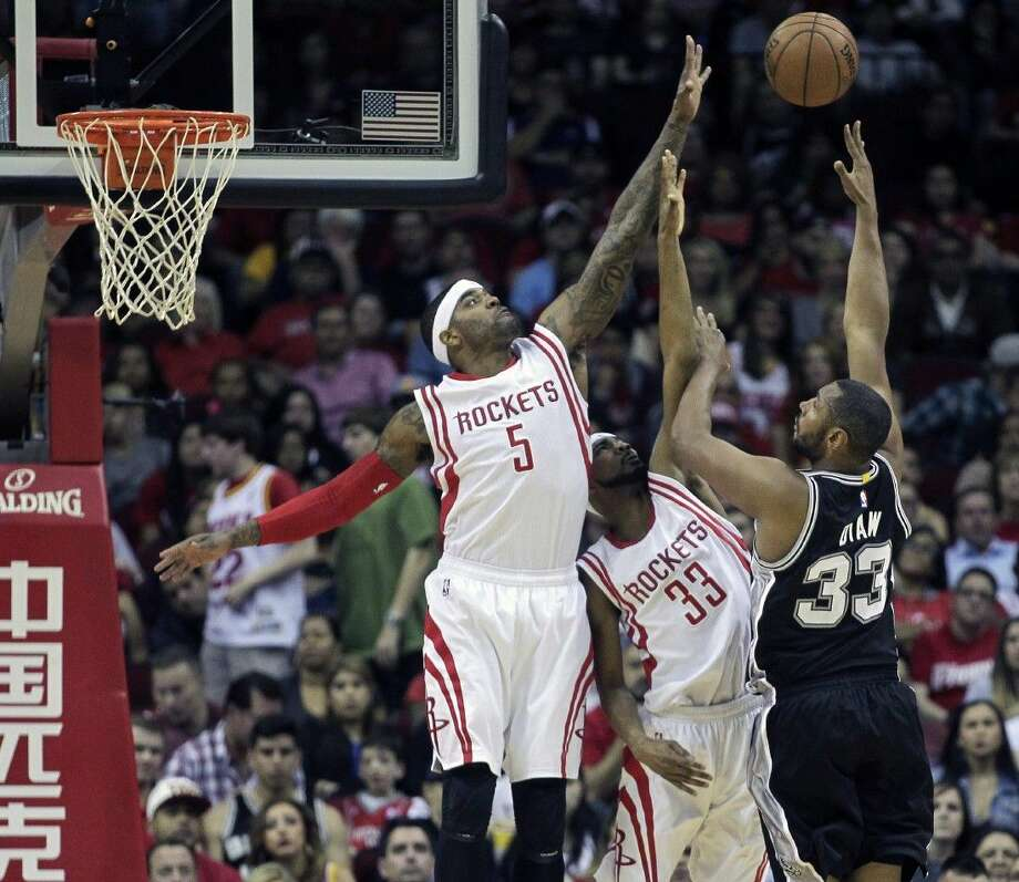 San Antonio Spurs center Boris Diaw has his shot blocked by Houston Rockets forward Josh Smith as guard Corey Brewer assists on Friday in Houston. Photo: Bob Levey