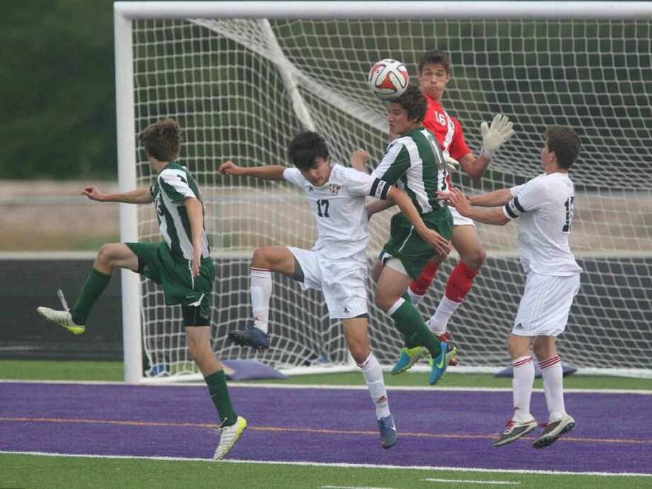 The Woodlands goalie Simon Boehme (16) goes up for a save during a Region II-5A area playoff game at College Station High School Thursday. The Woodlands defeated Lake Travis 2-0. To view or purchase this photo and others like it, visit HCNpics.com. Photo: Jason Fochtman
