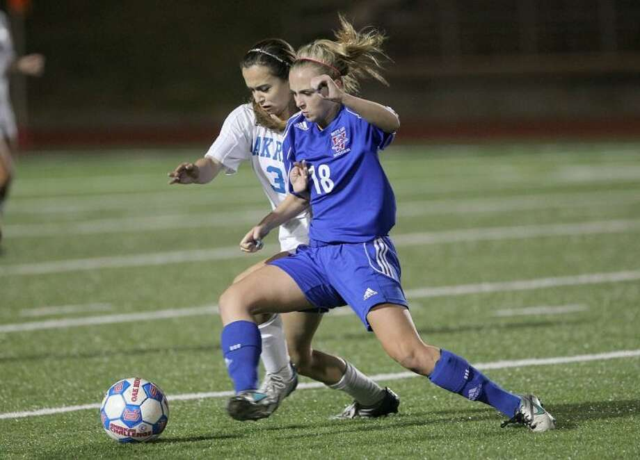 Oak Ridge defender Mercedes Rodgers (3) goes up against Westlake's Taylor Bock (18) during a Region II-5A area girls soccer playoff game in Bryan Friday. Westlake won 4-0. To view or purchase this photo and others like it, visit HCNpics.com. Photo: Jason Fochtman