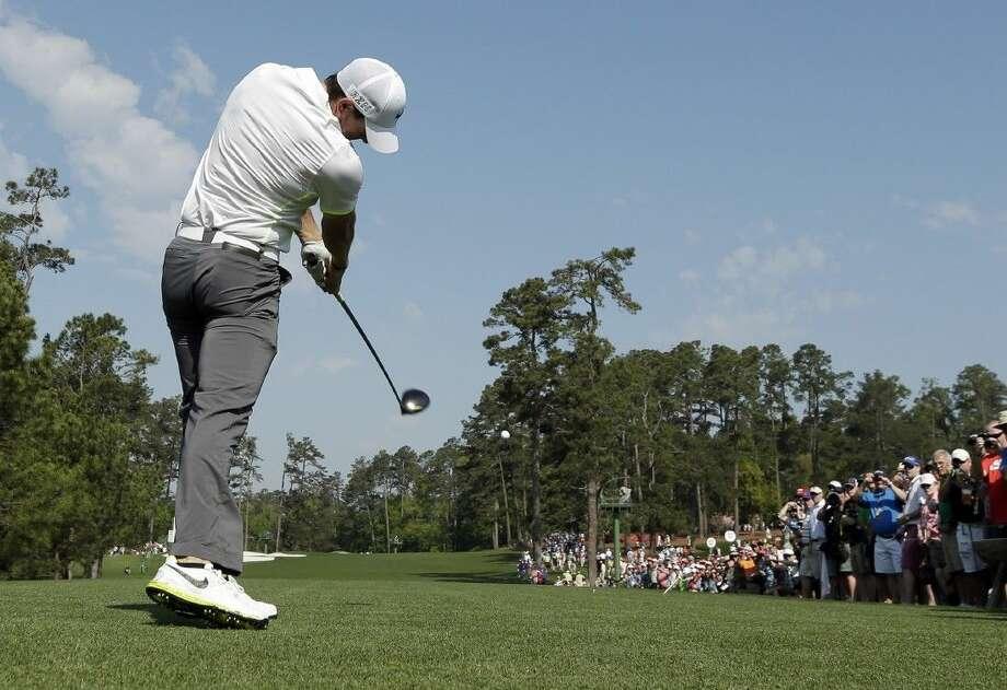 Rory McIlroy tees off on the third hole during a practice round for the Masters on Wednesday in Augusta, Ga. Photo: Charlie Riedel