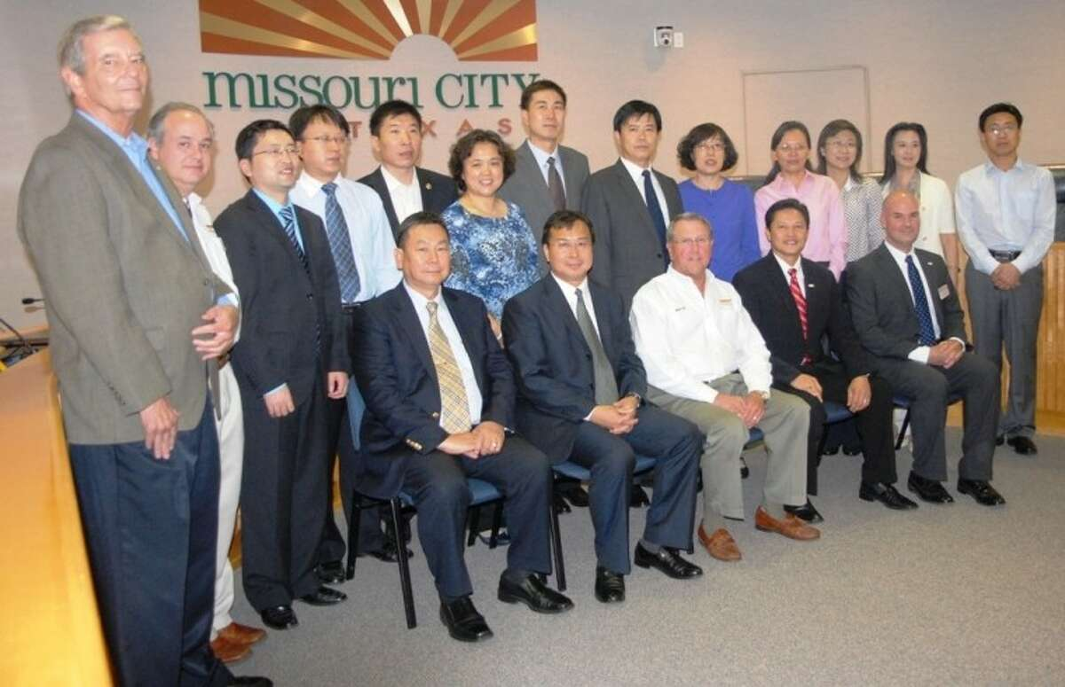 Dignitaries from Shandong Province in China visited Missouri City in November to learn about economic development opportunities and City government operations. Pictured with the delegates are Missouri City Economic Development Coordinator Bob Graf, far left, Assistant City Manager Bill Atkinson, next to Graf, Mayor Allen Owen, seated third from the right, Councilmember Danny Nguyen, seated to the right of Mayor Owen, and City Manager Ed Broussard, seated to the right of Nguyen.