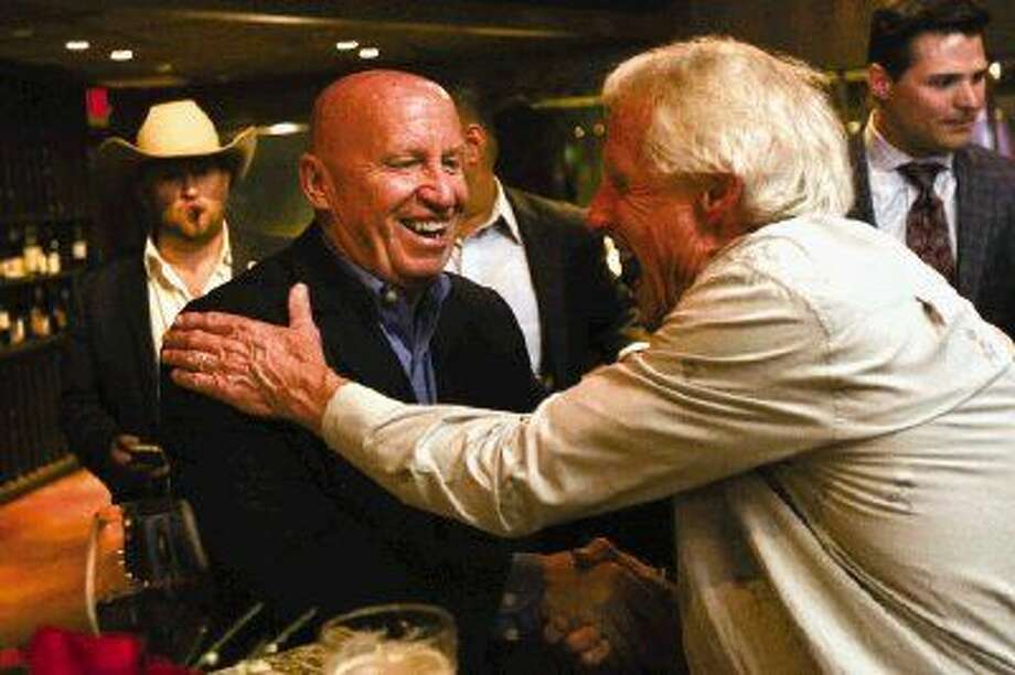 U.S. Rep. Kevin Brady, R-The Woodlands, thanks supporter The Woodlands resident Rick Hughes, right, during Brady's election night party on Tuesday at Crush Wine Lounge in The Woodlands. Photo: Michael Minasi