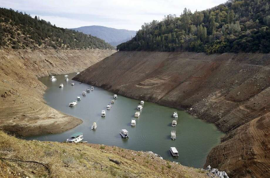 Houseboats in October float in the drought-lowered waters of Oroville Lake near Oroville, Calif. Photo: Rich Pedroncelli