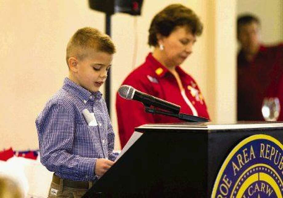 Cameron Berry, from Edward B. Cannan Elementary school in Willis ISD, reads a selection of his winning essay as part of the 'My American Hero' contest during the Lake Conroe Area Republican Women luncheon Thursday. Photo: Jason Fochtman