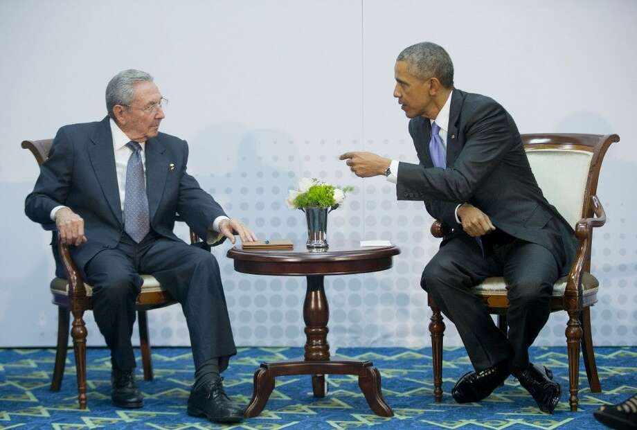 U.S. President Barack Obama leans over toward Cuban President Raul Castro during their meeting Saturday at the Summit of the Americas in Panama City, Panama. Photo: Pablo Martinez Monsivais