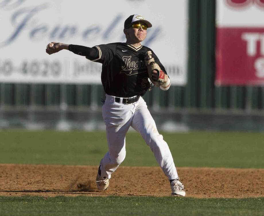 Conroe shortstop Tyler Linneweber throws to first after fielding a ground ball in the second inning of a baseball game Thursday in Conroe. Photo: Jason Fochtman