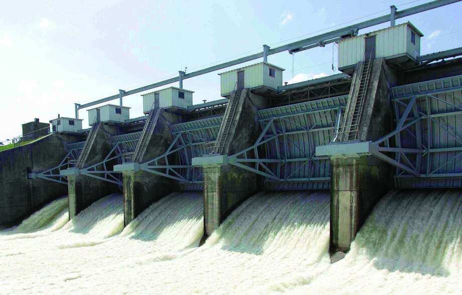 Water is released from the Lake Conroe dam into the San Jacinto River in May 2015.