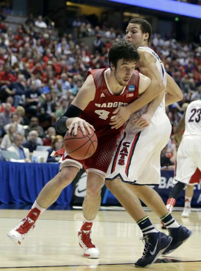 Wisconsin's Frank Kaminsky, left, is one of the rising stars for this year's Final Four. Kaminsky had 28 points and 11 rebounds in Wisconsin's 64-63 win over Arizona on Saturday night. Photo: Alex Gallardo