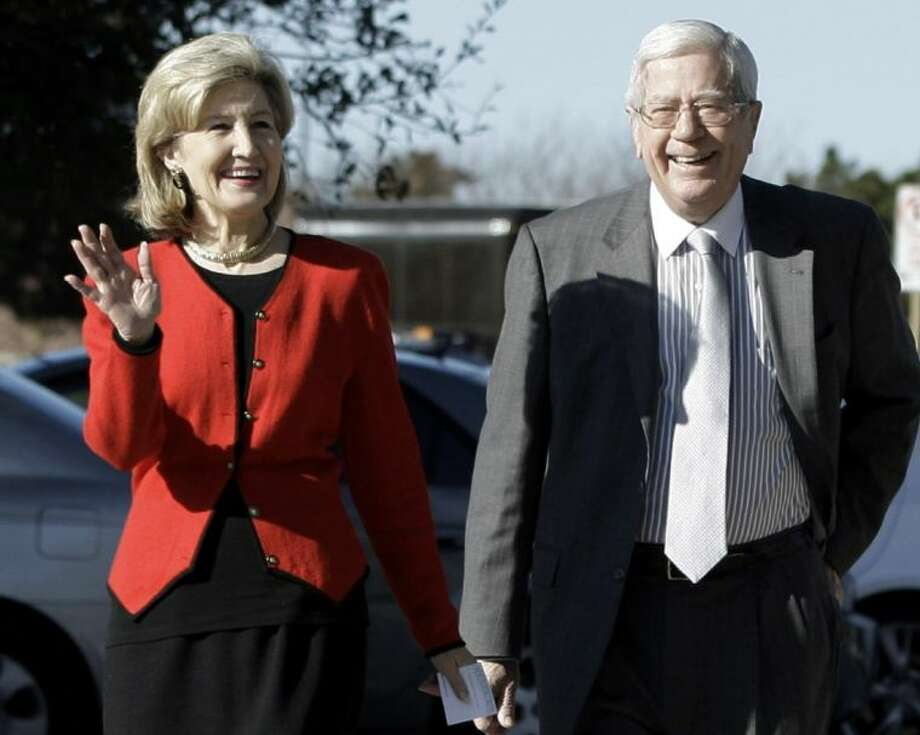 In this Feb. 16, 2010 file photo attorney Ray Hutchison, right, a former legislator, gubernatorial candidate and the husband of former U.S. Sen. Kay Bailey Hutchison, left, walks to a rally for his wife in Dallas. Photo: LM Otero
