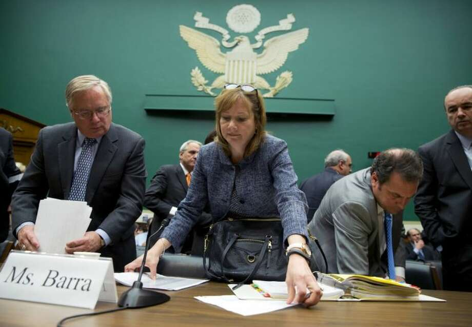 General Motors CEO Mary Barra, center, and and members of her staff, gather her paperwork after testifing on Capitol Hill in Washington, Tuesday, April 1, 2014, before the House Energy and Commerce subcommittee on Oversight and Investigation. The committee is looking for answers from Barra about safety defects and mishandled recall of 2.6 million small cars with a faulty ignition switch that's been linked to 13 deaths and dozen of crashes. Photo: Evan Vucci