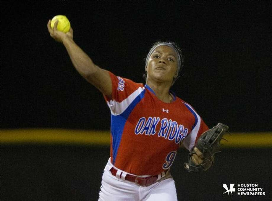 Oak Ridge shortstop Alicia Hill making a throw to first against Conroe in a game played March 1, 2015. Photo: Jason Fochtman