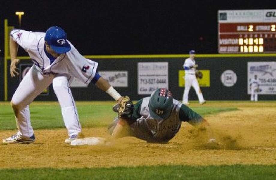 Oak Ridge's Kim Plympton, Jr. tries to elude The Woodlands' Ben Gooch (6) tag and gets back safely to first base during a baseball game at Oak Ridge High School Tuesday. The Woodlands won 9-6. To view or purchase this photo and others like it, visit HCNpics.com. Photo: Staff Photo By Ana Ramirez / The Conroe Courier