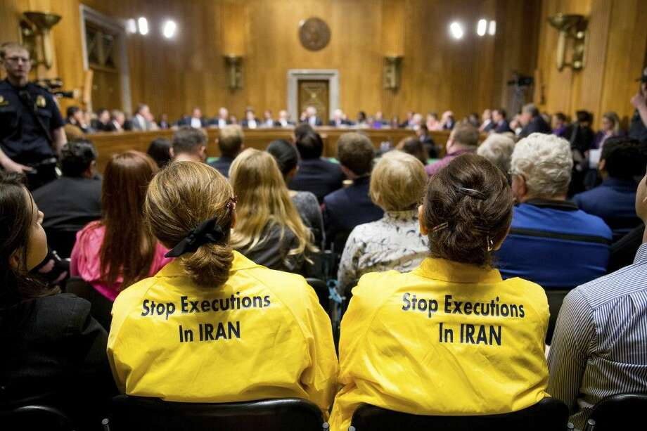 Protestors sit in the audience during a Senate Foreign Relations Committee meeting to debate and vote on the Iran Nuclear Agreement Review Act on Tuesday on Capitol Hill in Washington. Photo: Andrew Harnik