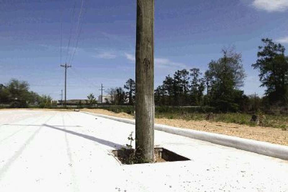 An electric pole sits in the path of an unfinished road near Bozman Intermediate School. Photo: Jason Fochtman