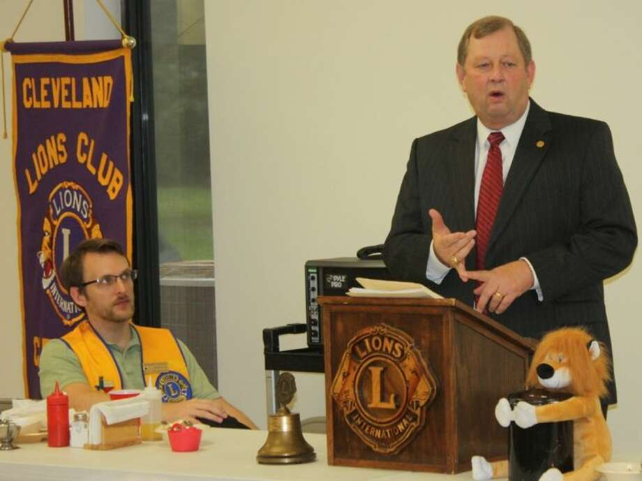 District 18 Representative John Otto discussed how funding in the state budget is distributed among education, health and human services and public safety Taylor Heilers (seated) listens intently at the most recent Lions Club meeting in Cleveland.