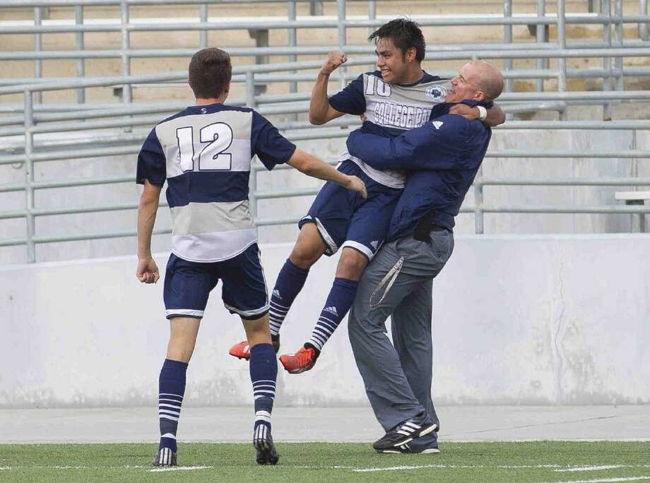 College Park's Rodrigo Perez, center, is lifted up in the air by head coach John Owens after Perez's first half goal during a District 16-6A boys soccer game against Oak Ridge Tuesday. College Park defeated Oak Ridge 3-1. Go to HCNpics.com to purchase this photos, and other like it. Photo: Jason Fochtman