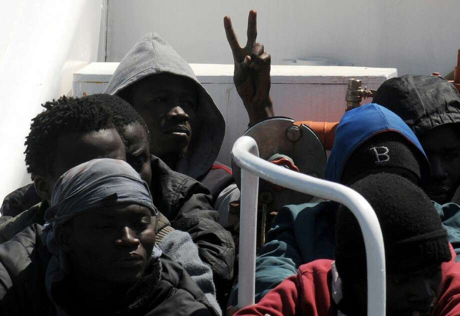 Migrants on Wednesday arrive at Palermo's harbor in Italy after being rescued at sea. Photo: Alessandro Fucarini