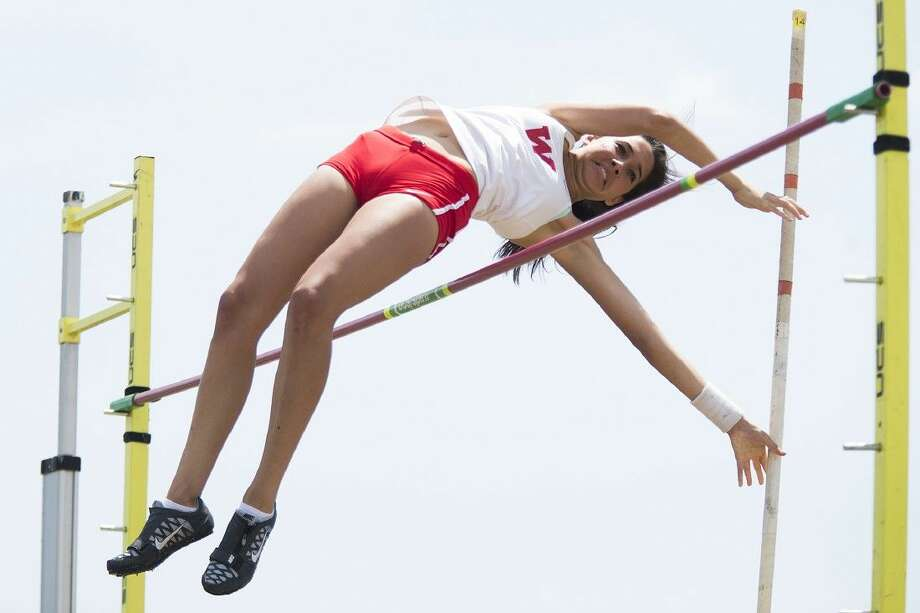 The Woodlands' Ellie Ramos finished second in the pole vault in area competition on Wednesday. Photo: ANDREW BUCKLEY
