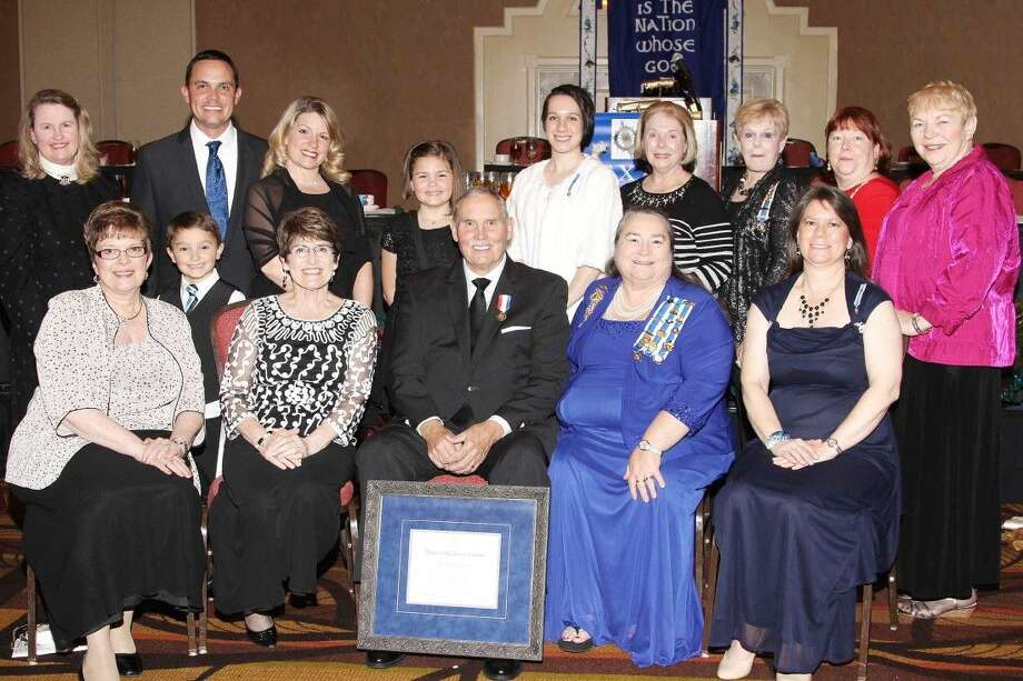 Chapter members joined the Williams family at the presentation: first row, left to right: Phyllis Stehm, Carson Williams, Lynne Williams, Richard E. Williams, Regent Tracy Olds, Sheronna McMahon; second row, Judy Weidner, Justin Williams, Amy Williams, Kinsey Williams, Lauren McMahon, Virginia Murray, Roselane Polnick, Trish Wunderlich and Bobbie Jackson. For information on membership and the programs of Margaret Montgomery Chapter DAR, email conroemmdar@gmail.com.