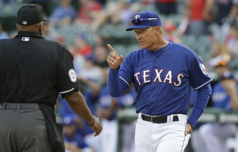 Texas Rangers manager Jeff Banister, right, questions a call during a game against the Houston Astros on Sunday. Photo: LM Otero