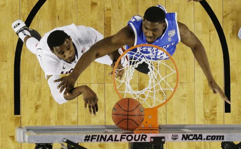Connecticut center Amida Brimah and Kentucky forward Alex Poythress battle for a rebound in the NCAA title game. UConn won 60-54. Photo: David J. Phillip