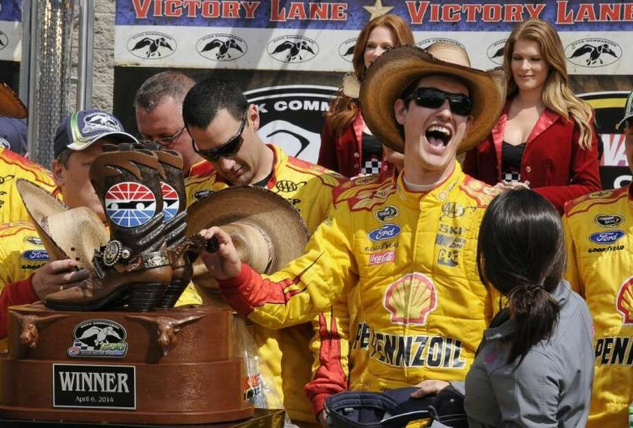 Joey Logano celebrates in Victory Lane after winning the NASCAR Sprint Cup race at Texas Motor Speedway. Photo: Larry Papke