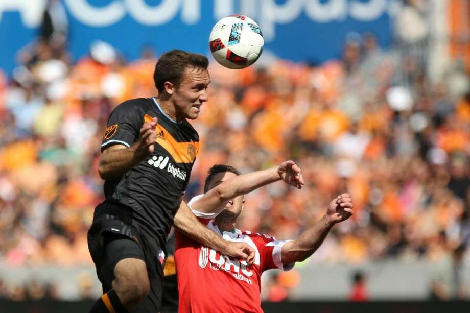 Houston Dynamo's Christian Maidana (8) heads the ball in for a goal during the MLS game against New England Revolution on Sundayat BBVA Compass Stadium. Photo: Michael Minasi