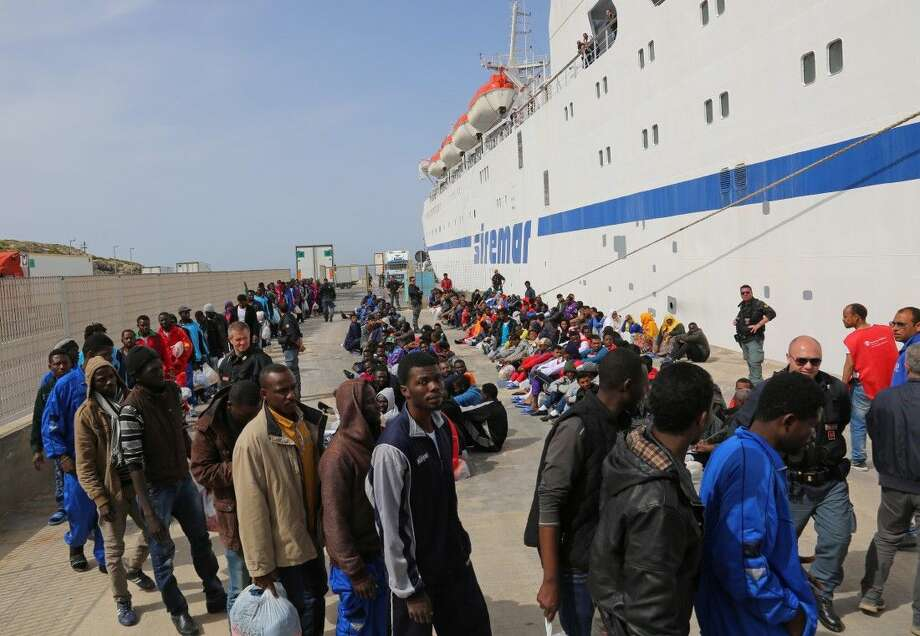 Migrants waiting to board a cruise ship as they leave the island of Lampedusa on Friday.