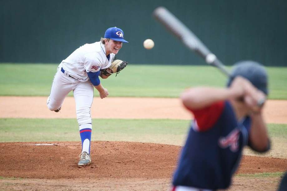 Oak Ridge's Durbin Feltman throws a pitch against Atascocita on Friday at Oak Ridge High School. To view more photos from the game, go to HCNPics.com. Photo: Michael Minasi