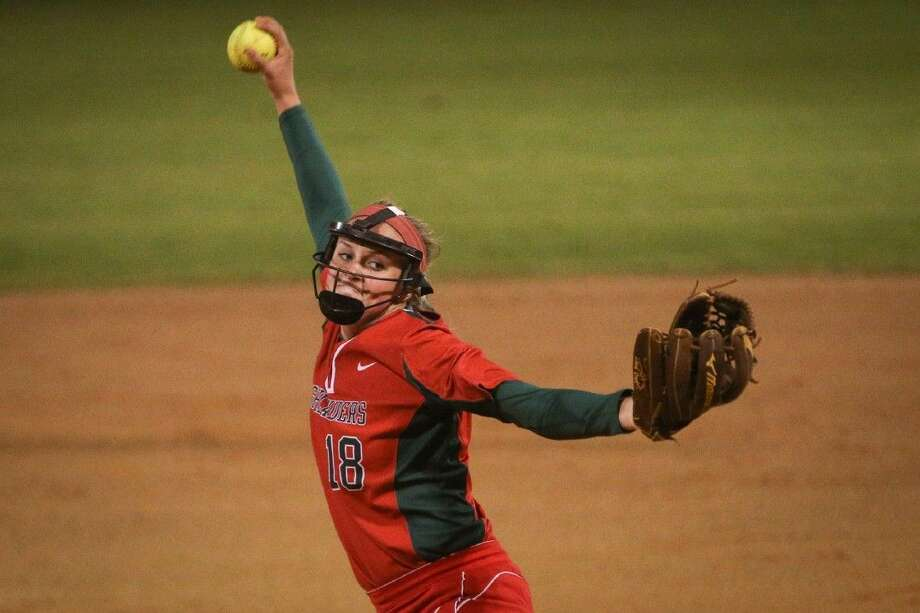 The Woodlands' Emily Langkamp (18) throws a pitch during a high school softball game against Bellaire on Saturday at The Woodlands High School. To view more photos from the game, go to HCNPics.com. Photo: Michael Minasi