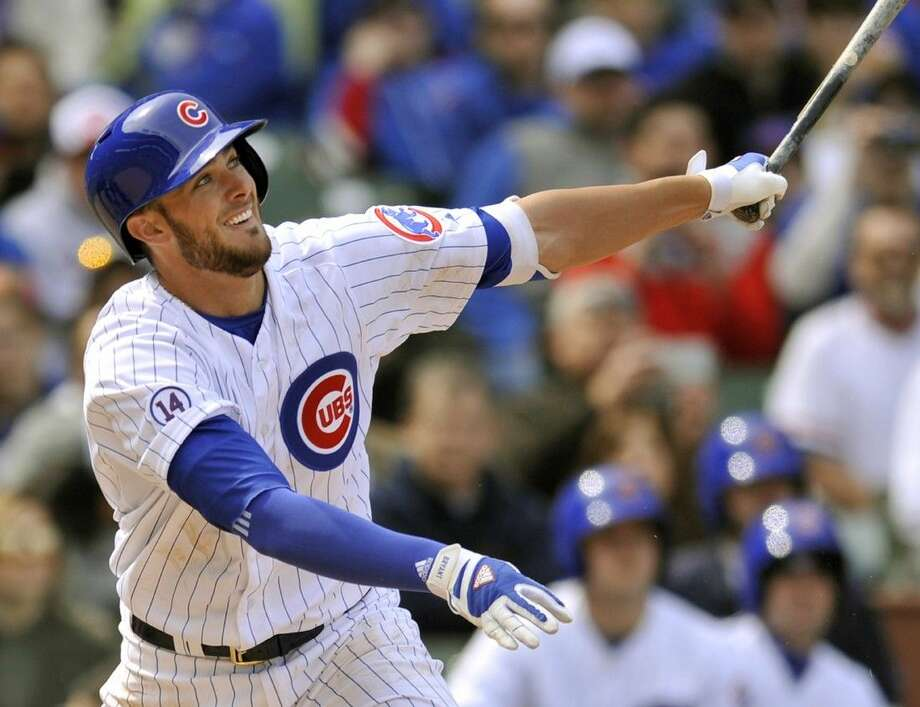 Cubs rookie Kris Bryant watches his RBI single in a win over the Padres. Photo: Paul Beaty