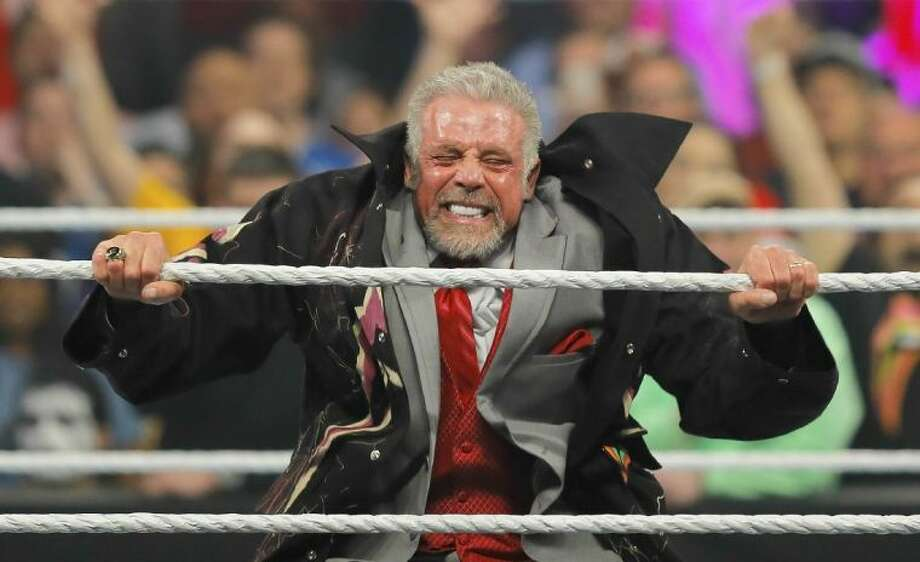 In this Monday, April 7, 2014 photo, James Hellwig, better known as The Ultimate Warrior, performs for the audience during WWE Monday Night Raw at the Smoothie King Center in New Orleans. The WWE said Hellwig, one of pro wrestling's biggest stars in the late 1980s, died Tuesday, April 8, 2014. He was 54. Photo: David Grunfeld