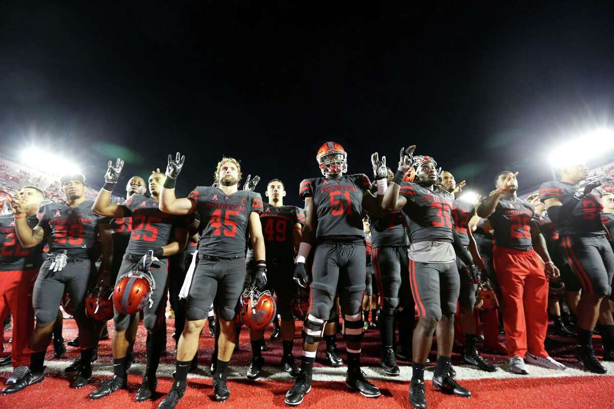 University of Houston football team celebrate after defeated University of Connecticut at TDECU Stadium Thursday, Sept. 29, 2016, in Houston. The Cougars defeated the Huskies 42-14.
