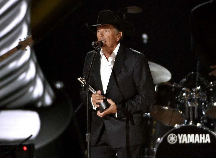 George Strait accepts the milestone award at the 50th annual Academy of Country Music Awards at AT&T Stadium on Sunday. Photo: Chris Pizzello