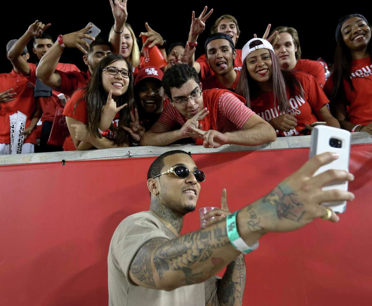 Rapper Kirko Bangz takes a selfie with University of Houston fans during the second half of the game against University of Connecticut at TDECU Stadium Thursday, Sept. 29, 2016, in Houston. The Cougars defeated the Huskies 42-14.