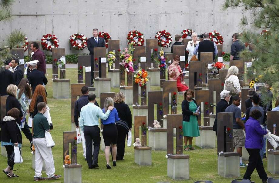 People move into the Field of Empty Chairs , where bombing victims are memorialized, following a ceremony for the 20th anniversary of the Oklahoma City bombing at the Oklahoma City National Memorial in Oklahoma City Sunday. Photo: Sue Ogrocki